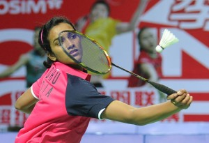 P.V. Sindhu of India hits a return to Eriko Hirose of Japan during their women's singles first round match at the China Open badminton tournament in Shanghai on November 14, 2012.  AFP PHOTO/Peter PARKS