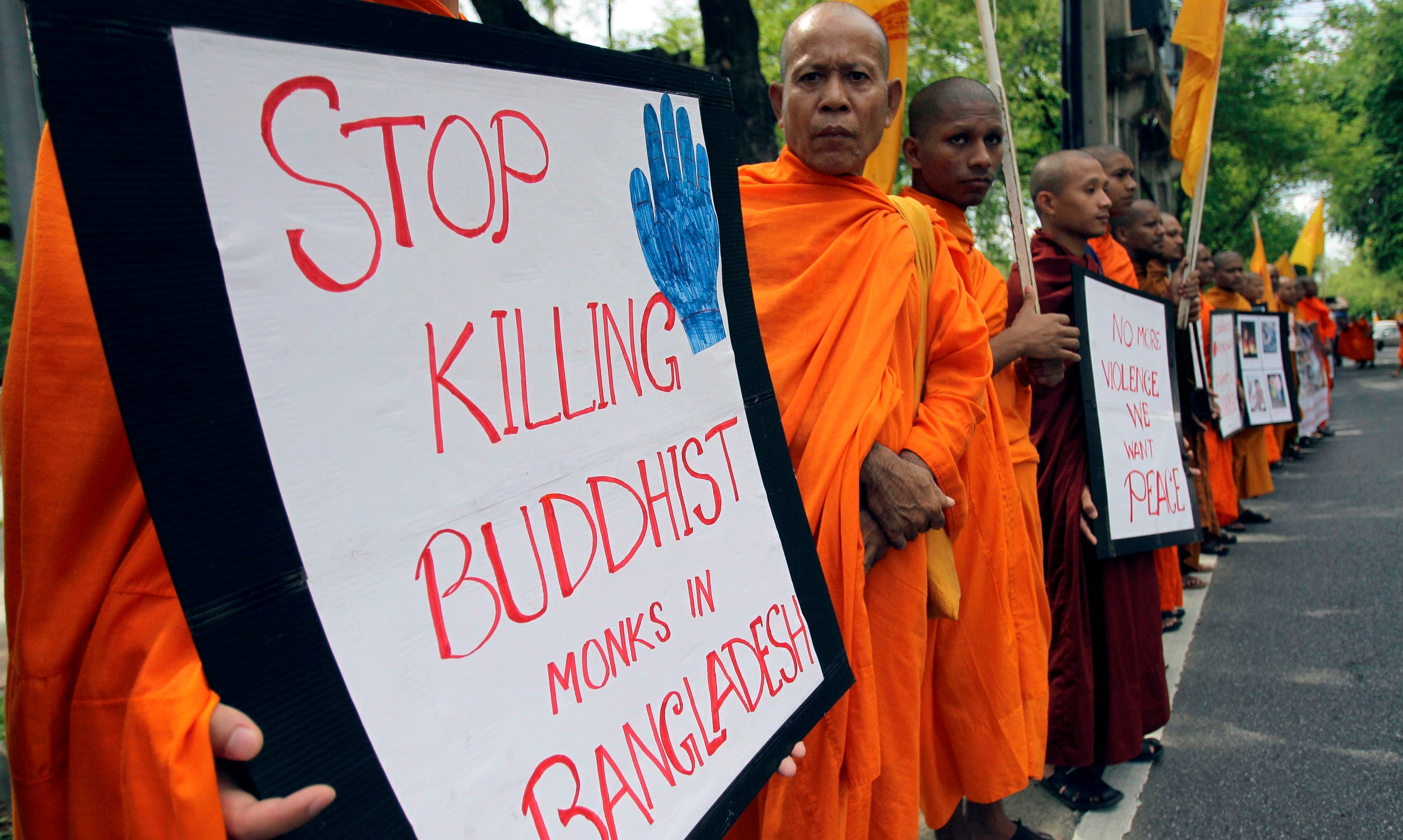 Buddhist monk hacked to death in Bangladesh - Canasian ...